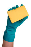 Cleaning sponge. Hand holding yellow cleaning sponge; isolated on white Royalty Free Stock Photo