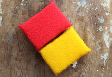 Cleaning sponge. Colorful kitchen scouring sponge for cleaning on rustic wooden background stock photography