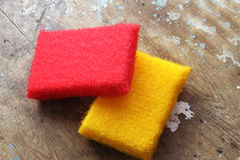Cleaning sponge. Colorful kitchen scouring sponge for cleaning on rustic wooden background stock photos