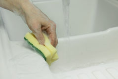 Cleaning with sponge scouring pad closeup Stock Image