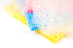 Cleaning sponges with bubbles. Pink blue and yellow cleaning sponges with bubbles Stock Images