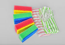 Cleaning sponges,towels and shiny glasses Royalty Free Stock Images