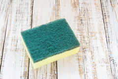 Cleaning sponges on wooden background Royalty Free Stock Photography