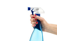 Cleaning spray in hand Royalty Free Stock Photo