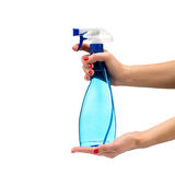Cleaning spray in hand close-up Royalty Free Stock Photography