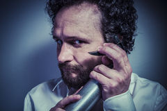 Cleaning spray, man with intense expression, white shirt Royalty Free Stock Photos