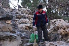 Cleaning staff in Beihai Park stock photo