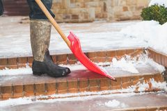 Cleaning of stair steps from plastics snow shovel Royalty Free Stock Photos