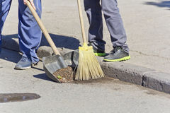 Cleaning street with broom and shovel Stock Image