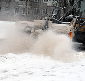 Cleaning of the street. Snow and sand. Royalty Free Stock Photos