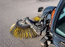 Cleaning streets of the city with the help of a harvesting machine Stock Photo