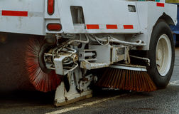 Cleaning streets of the city with the help of harvesting machine stock photo