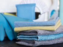 Cleaning stuff. Blue and grey microfiber napkins on black ground Stock Photography