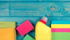 Set of cleaning up stuff on blue wooden background. Stock Images