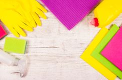 Set of cleaning up stuff on wooden background. Stock Image