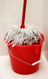 Cleaning supplies. Mop and bucket for washing floors Royalty Free Stock Photo