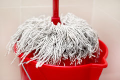Cleaning supplies. Mop and bucket for washing floors Stock Image
