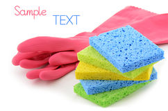 Cleaning supplies. Rubber gloves and cellulose sponges ready for household cleaning tasks Stock Images