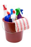 Cleaning Supplies. Various cleaning utensils in a bucket. Isolated on a white background Royalty Free Stock Photography