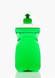Cleaning supplies. Bottle of green bubbling dish liquid isolated on a white background Royalty Free Stock Image