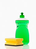 Cleaning supplies. Bottle of green bubbling dish liquid isolated on a white background Royalty Free Stock Photography