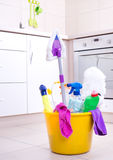 Cleaning supplies in bucket on kitchen floor royalty free stock images
