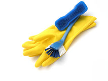 Cleaning supplies and gloves. A pair of rubber gloves and cleaning supplies Stock Image