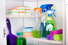 Cleaning supplies in pantry. Cleaning supplies and tools arranged on shelves in pantry royalty free stock photos