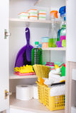 Cleaning supplies in pantry. Cleaning supplies and tools arranged on shelves in pantry stock images