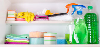 Cleaning supplies in pantry. Cleaning supplies and tools arranged on shelves in pantry stock photos