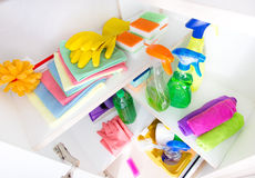 Cleaning supplies in pantry. Top view of cleaning supplies and tools arranged on shelves in pantry royalty free stock photos