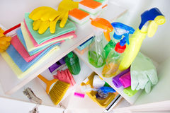 Cleaning supplies in pantry. Top view of cleaning supplies and tools arranged on shelves in pantry stock photo