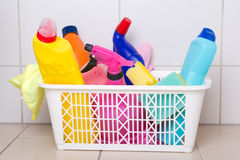 Cleaning supplies in plastic box on tiled floor Royalty Free Stock Images