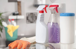 Cleaning supplies. Plastic detergent bottles. House cleaning products on table stock photos