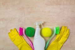 Cleaning supplies and products on wooden background, housework concept, top view with copy space stock photos
