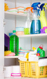 Cleaning supplies storage. Cleaning supplies and tools stored on shelves in storage place Stock Photos