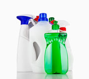 Cleaning supplies. Various bottles with cleaning supplies isolated on white background Royalty Free Stock Images