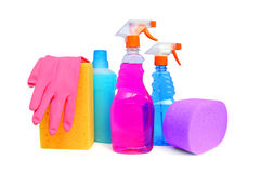 Cleaning supplies. On white background including several spray bottles of chemicals, rubber gloves and sponges stock photos