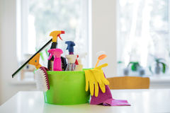 Cleaning supplies on white table in basket Stock Photo