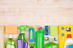 Cleaning supplies on wooden background with copy space Stock Image