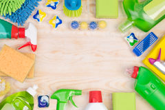 Cleaning supplies on wooden background with copy space Royalty Free Stock Photography