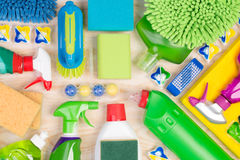 Cleaning supplies on wooden background. Top view Stock Photos