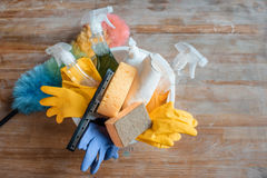Cleaning supplies on wooden table Royalty Free Stock Photography