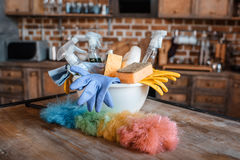Cleaning supplies on wooden table indoors Stock Images