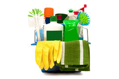 Cleaning Supplies With Yellow Gloves. Very colorful shot of cleaning supplies with yellow rubber gloves and green cleaning cloth hanging on the outside.   on Stock Images