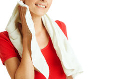 Cleaning sweat. Young woman is cleaning sweat after exercise, isolated on white royalty free stock photos