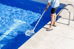 Cleaning the swimming pool with a net Stock Images