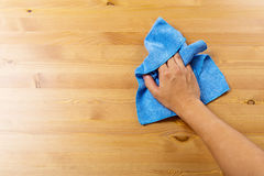 Cleaning table by blue rag. With hand Stock Images