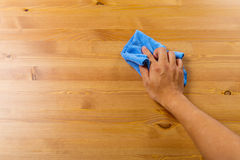 Cleaning table by hand Stock Photography