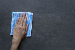 Cleaning table by woman hand Royalty Free Stock Photo